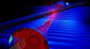 Nanofiber evanescent light (red) entering probe fiber (larger glass cylinder). (Credit: E. Edwards)