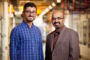 A robot under development at the University of Illinois automates the labor-intensive process of crop phenotyping, enabling scientists to scan crops and match genetic data with the highest-yielding plants. Agricultural and biological engineering professor Girish Chowdhary, right, is working on the $3.1 million project, along with postdoctoral researcher Erkan Kayacan.(Source: University of Illinois)