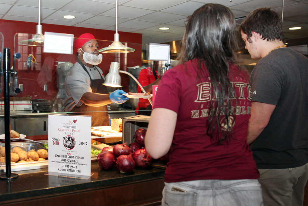 FSU students line up for the special Seminole Pride Beef dinner of carved striploin steak, baked potato bar, creamed spinach and seasoned buttered corn in the Suwannee Room dining hall Oct. 14. (Beverly Bidney photo)