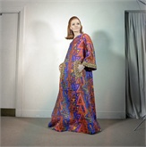 Evening caftan with embroidered sleeves and cuffs from Oscar de la Renta in New York, 1963. It is made of multi-colored cotton and acetate fabric. (AP Photo)