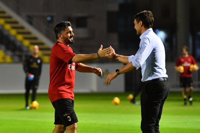 AC Milan's Italian coach Gennaro Gattuso (L) greets his former teammate Paolo Maldini (R) during training at the King Abdullah Sports City Stadium in Jeddah on January 15, 2019, a day before the Supercoppa Italiana final against Juventus. (Photo by GIUSEPPE CACACE / AFP or licensors / AFP) (Photo credit should read GIUSEPPE CACACE/AFP/Getty Images)