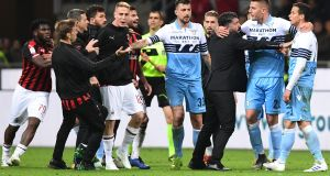 AC Milan's Italian coach Gennaro Gattuso (3rdR) and Lazio's Serbian midfielder Sergej Milinkovic-Savic (2ndR) intervene to put an end to a scuffle between Lazio's Brazilian defender Luiz Felipe (R) and AC Milan's Ivorian midfielder Franck Kessie (Far L) at the end of the Italian Serie A football match AC Milan vs Lazio Rome on April 13, 2019 at the San Siro stadium in Milan. (Photo by Miguel MEDINA / AFP) (Photo credit should read MIGUEL MEDINA/AFP/Getty Images)