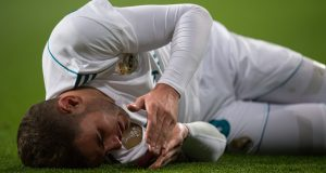 MADRID, SPAIN - MARCH 03: Theo Hernandez of Real Madrid reacts after taking a knock during the La Liga match between Real Madrid and Getafe at Estadio Santiago Bernabeu on March 3, 2018 in Madrid, Spain. (Photo by Denis Doyle/Getty Images)