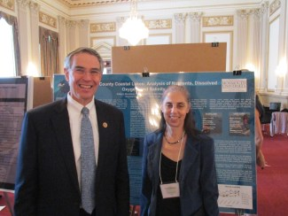 Former Rep. Rush Holt (NJ-12) and Dr. Ellen Rubenstein of Monmouth University with Dr. Rubenstein's poster about her analysis of local lakes presented at the 2014 NSCSE Washington Symposium Capitol Hill Poster Session