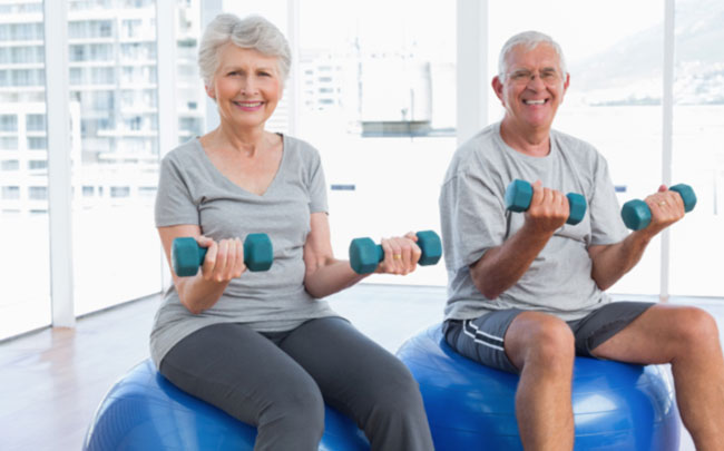 active-senior-couple-dumbbells