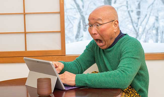 senior-with-laptop-shocked