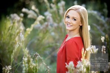Super cute senior portraits blond female blue eyes smile red blouse shirt outdoors tallgrass natural lighting senior portraits ideas