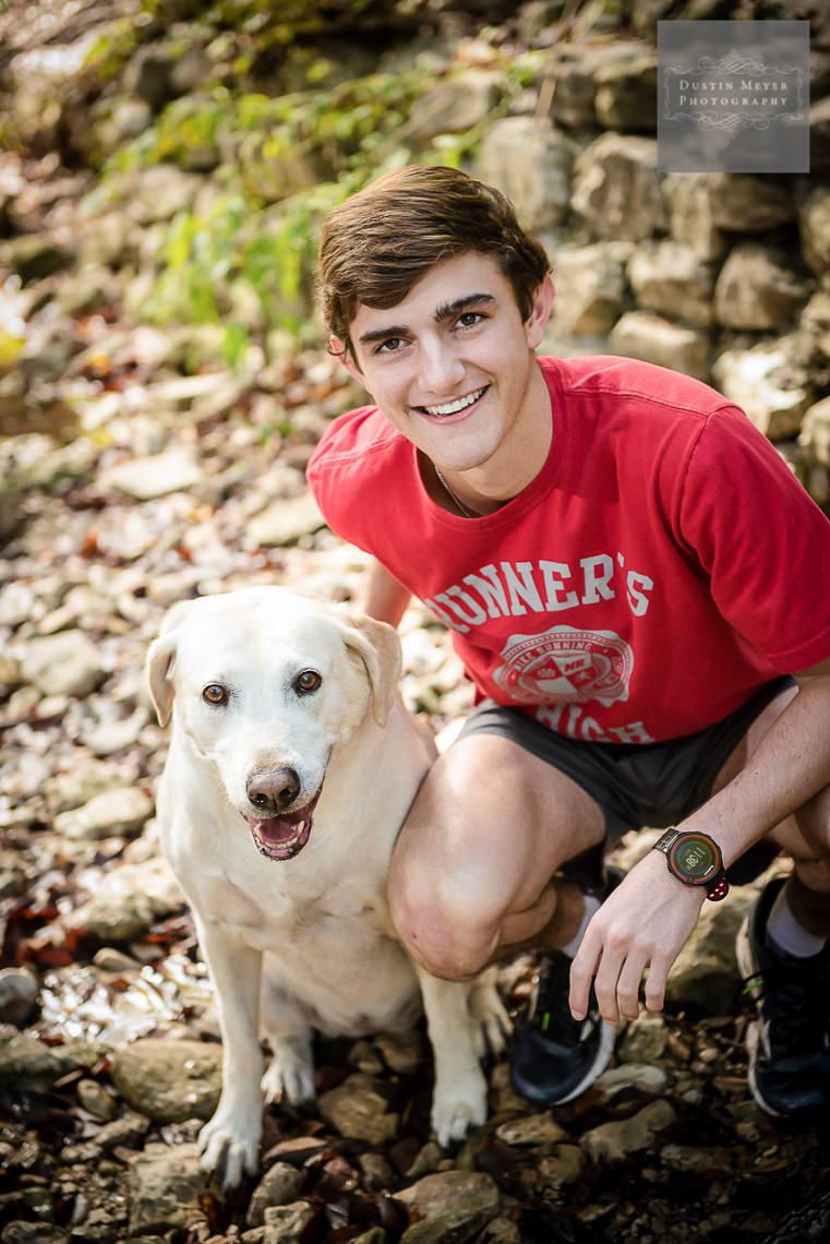 senior portrait with his dog