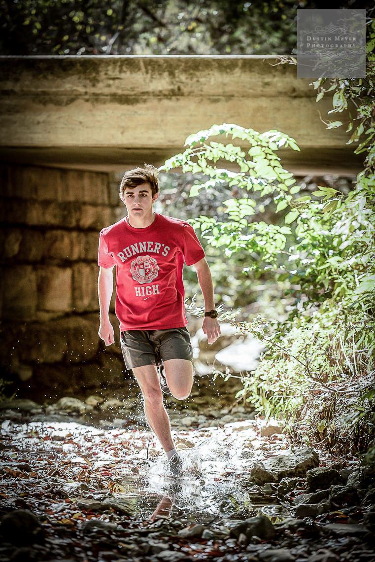 senior portrait austin outdoor photography nature creek water running track runner ideas