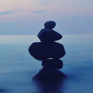 Rocks balanced on a foggy shore