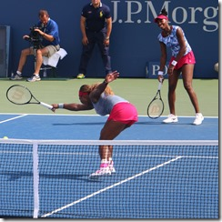 Photo #2: Ball from poach is returned and Serena tries to play it; Venus cracking up in background.