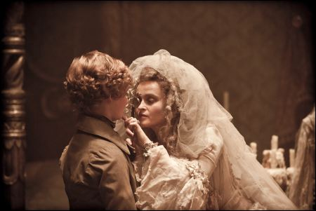 Young Pip (Toby Irvine) & Miss Havisham (Helena Bonham Carter) in 'Great Expectations' ©pathéfilms