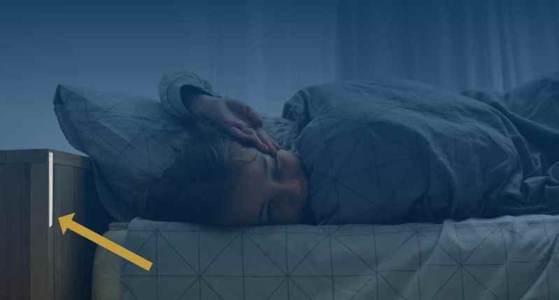 child in bed monitored with Strips Presence