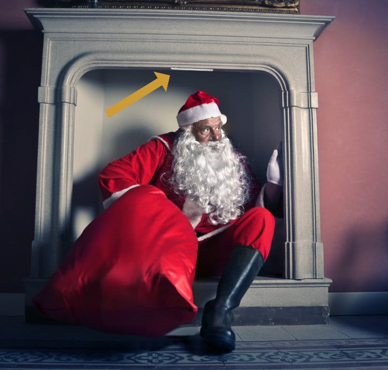 santa claus coming out chimney monitored with strips presence
