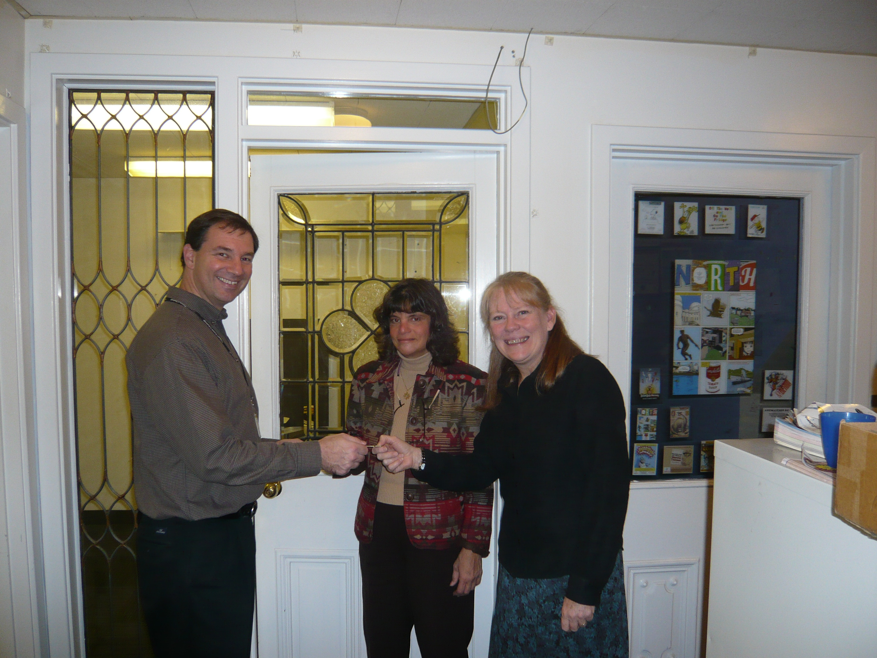 Margaret and Paula get the keys to their new office at the Children's Museum