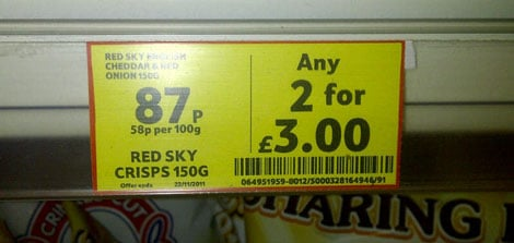 A Yellow Sticker That Reads '87p For One, Any 2 For £3.00'