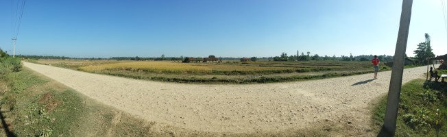 A panorama on the road at the edge of the village