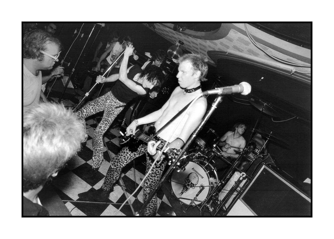 The Dead Boys performing at Bookies Club 870 in Detroit, Michigan on August 7, 1978. Pictured:bassist ???, guitarist ??? singer Stiv Bators, guitarist Cheetah Chrome, drummer ???