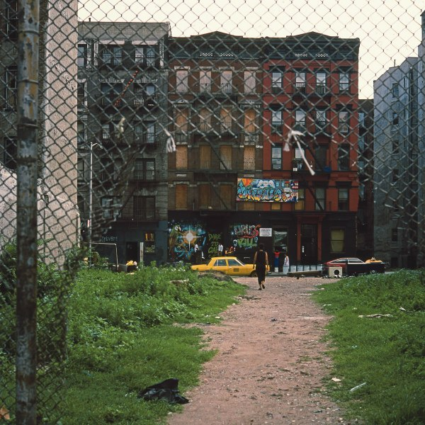 Fence, E. 8th St. bet. Ave. B & Ave. C, 1984, photograph by Philip Pocock.