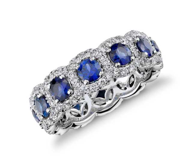 Sapphire and Diamond Halo Eternity Ring in 18k White Gold Exquisite, velvety blue sapphires are encircled by brilliant pavé-set diamond halos in this eye-catching 18k white gold eternity-style ring.