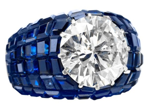 A Stunning Van Cleef & Arpels, An Invisibly Set Ring, designed with a central circular cut diamond weighing 5.22 carats, E color, SI2 clarity, to the invisibly set.