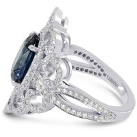 An Exquisite 3.93Cts Sapphire Side Diamonds Engagement Extraordinary Ring Set in Platinum