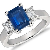 A Gorgeous Emerald Cut Sapphire and Diamond Ring in 950 Platinum