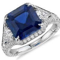 An Exquisite 5.10 Carat Emerald-Cut Sapphire and Diamond Halo Ring in 18k White Gold