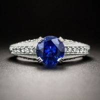 1.38 CARAT ROUND SAPPHIRE, PLATINUM AND DIAMOND VINTAGE STYLE ENGAGEMENT RING