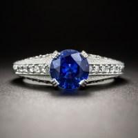 1.38 CARAT ROUND SAPPHIRE, PLATINUM AND DIAMOND VINTAGE STYLE ENGAGEMENT RING