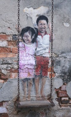 Penang - Brother and Sister on a Swing