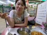 Sister K eating soondeh (pig intestines with coragulate blood clots,...yummm..)