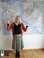 Me being dwerpy in front of our area's map (just hung it up this week:)