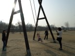 Cute family on a big swing (I know I'm a creep for taking their picture! It was just a Kodak moment!)