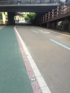 Watch for bikes, then cross to the ramp on the right.
