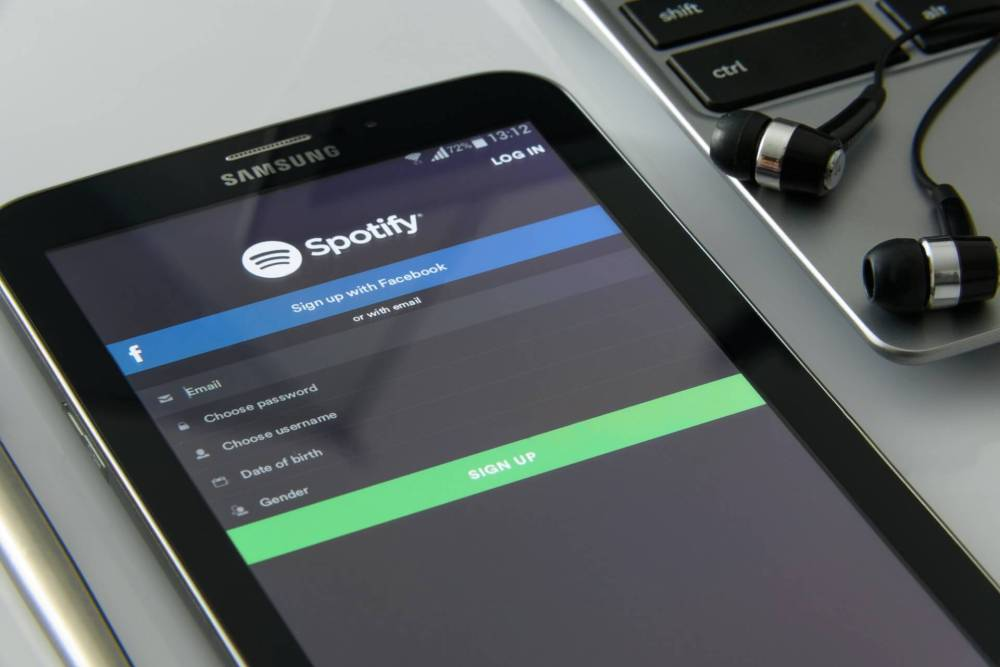 spotify call to action shown on a phone