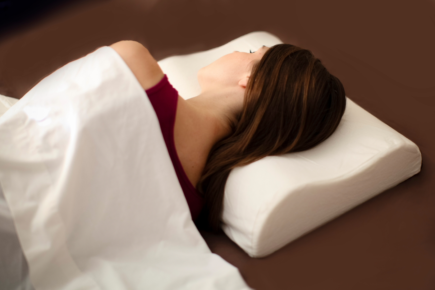 Memory foam neck support pillow to aid in neck pain relief