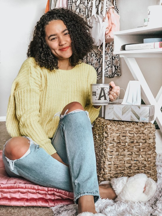 Girl Sitting on a Floor Cushion Holding a Mug