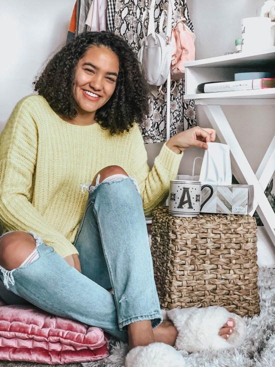 Girl Sitting on a Floor Cushion Getting a Tissue