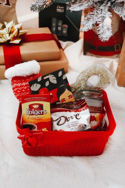 Container with stocking stuffers inside with gifts behind it.
