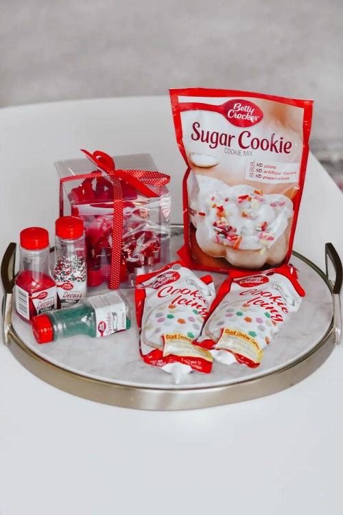 Sugar cookies, cookie icing, sprinkles, ad holiday cookie cutters.