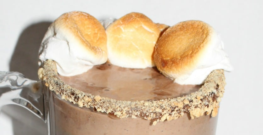 a peanut butter smores smoothie topped with toasted marshmallows