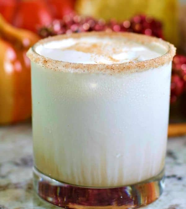 pumpkin spiced white russian in a glass rimmed with pumpkin pie spice and sugar on a counter