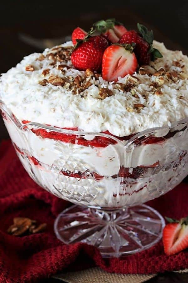 southern strawberry coconut punch bowl cake on a red cloth