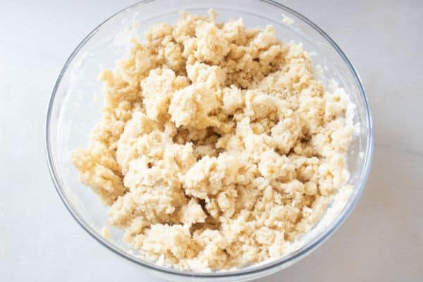 crumble mixture in a glass bowl on a white counter