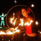 Members of Northwest Fire Conclave perform during Burning Man 2013 arts and music festival in the Black Rock Desert of Nevada