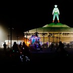 People make their way pass the Man during the Burning Man 2013 arts and music festival in the Black Rock Desert of Nevada