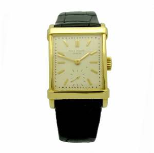 Vintage Patek Philippe reference 2531 in 18kt yellow gold, square case, cream dial with gold tone stick hour markers.
