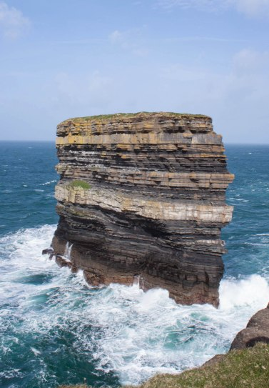 According to legend, this striped sea stack, Dún Briste (broken fort), was cut off from the headland by St Patrick when a pagan chieftain refused to convert to Christianity. St Patrick struck the ground with his crozier, splitting off the landmass with the chieftain on top.