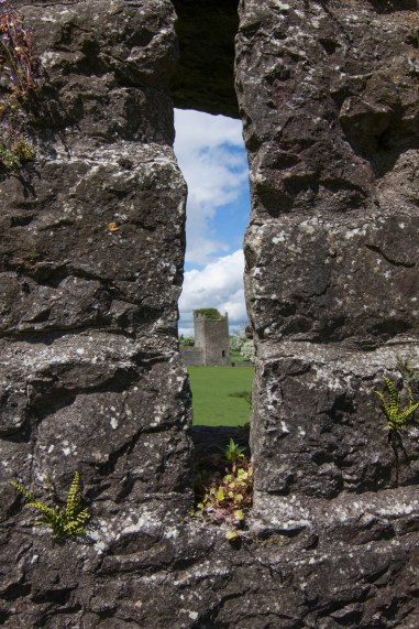 A glimpse of Kells Priory through an arrow slit in the stone wall. The Augustinian monastic community was founded in 1193 in County Kilkenny.